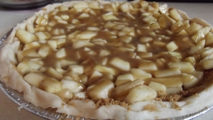 Almost ready for the oven. Apple mixture, brown sugar sauce already in it..now to top it off with our graham crumb mixture!