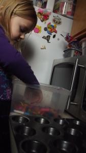 Kaelynn designing her crayons.