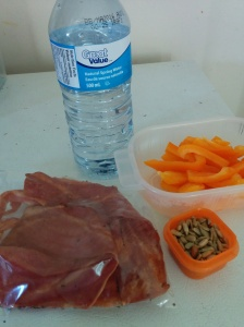 Snacktime #1 - Orange pepper, chicken bacon, sunflower seeds and water.